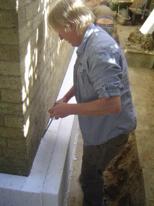 Mike using expanding foam to fill the gaps