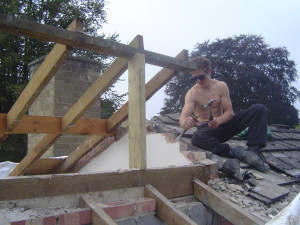 Jordon removing some brickwork to avoid the cold bridge
